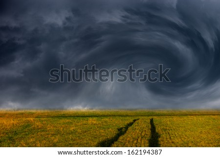 Storm dark clouds over field - dramatic sky.