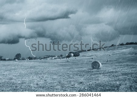 Storm in countryside in summer - stock photo