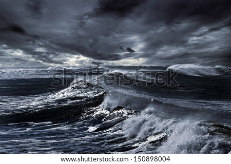 Storm in ocean with big windy waves; Northeast Atlantic Coast; enhanced sky; toned blue - stock photo