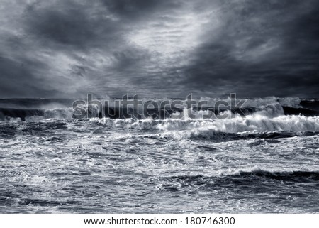 Storm in ocean with windy waves. Northeast Atlantic Coast. Enhanced sky. Toned blue. - stock photo