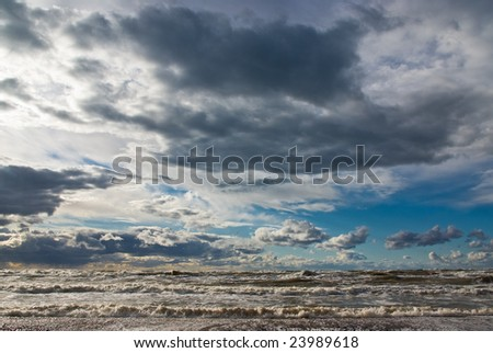 Storm in the sea with clouds and waves - stock photo