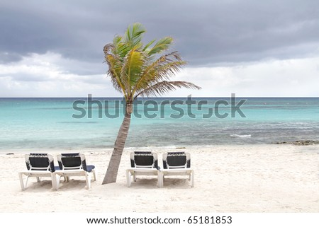 Storm on a tropical white sand beach - stock photo
