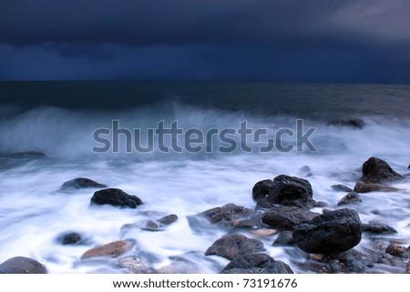 Storm on the ocean beach - stock photo