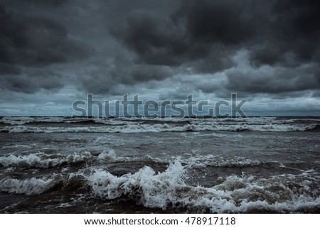 Storm on the ocean coast in evening