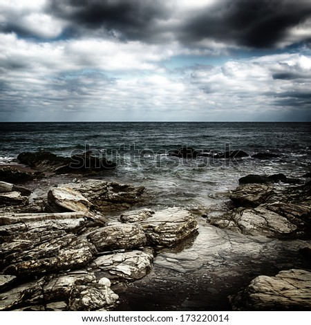 Storm on the sea after a rain with a retro effect - stock photo