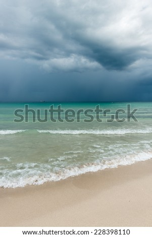 Storm over Miami Beach.  Ocean water surface under cloudy sky. Great impression of distance and solitude