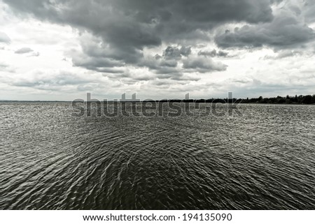 Storm over the lake  - stock photo