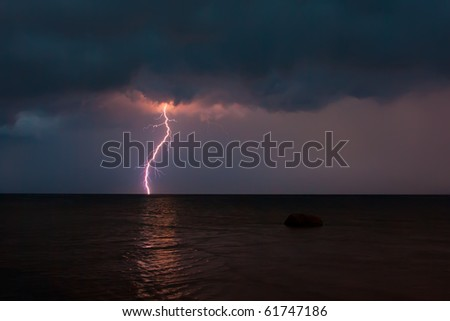 Storm over the sea with lightning - stock photo