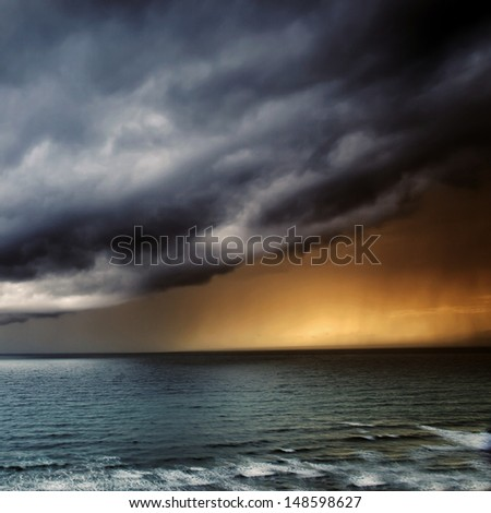 Storm Passing over Sea - dramatic seascape at sunset / sunrise for power of nature, sea imagery / doom and adventure.