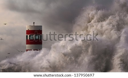 Storm wave over lighthouse