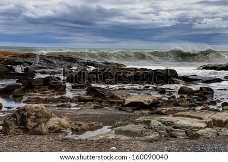 Storm waves breaking on rocks - stock photo