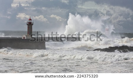 Storm waves over the Lighthouse, Portugal - enhanced sky - stock photo