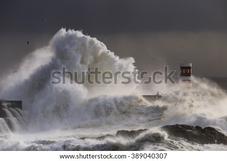 Storm with big waves near a lighthouse in Porto, Portugal