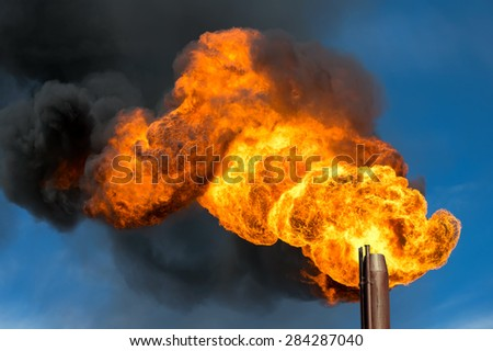 Storming flame of an oil torch - stock photo