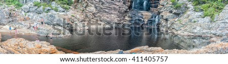 STORMS RIVER MOUTH, SOUTH AFRICA - MARCH 1, 2016:  Unidentified tourists at the pool below the waterfall at the end of the Waterfall Trail which is part of day one of the renowned Otter trail
