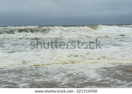 Stormy Atlantic Ocean with storm clouds at the Outer Banks of North Carolina.