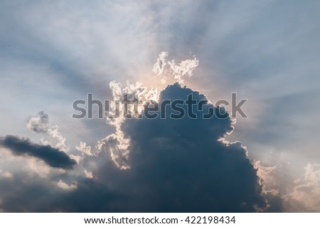 stormy cloud with sun rays - stock photo