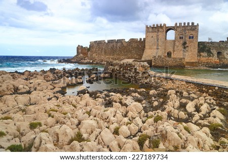 Stormy clouds above the sea and Venetian fortress of Methoni, Greece