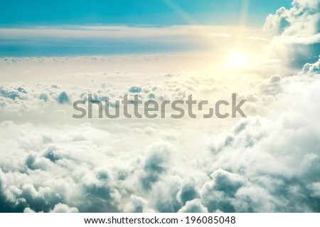 Stormy clouds and sun. View from aeroplane. - stock photo