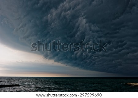 Stormy clouds gathering  over the sea - stock photo