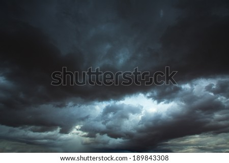 Stormy clouds gray low key sky with dramatic shadows and lights - stock photo