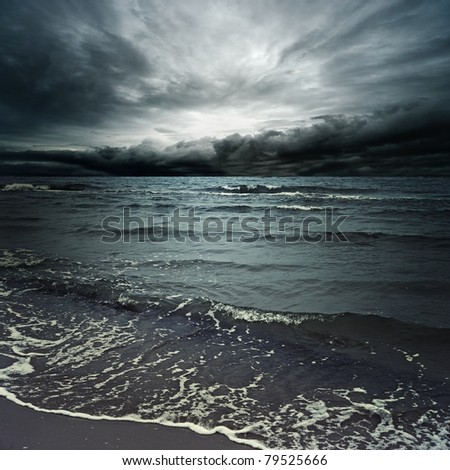Stormy clouds over dark ocean - stock photo