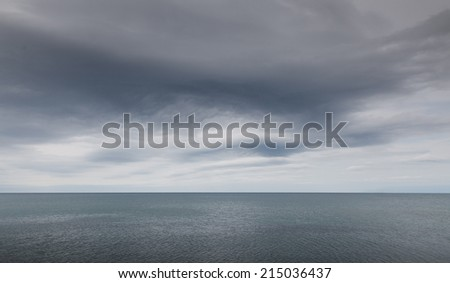 Stormy clouds over dark sea