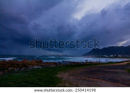 Stormy clouds over ocean and shore