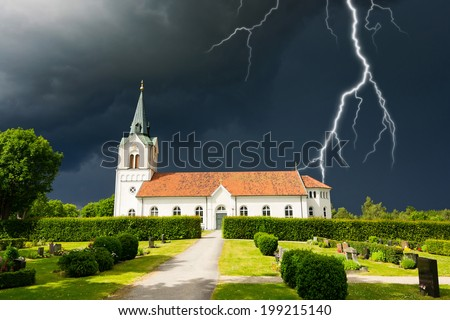 Stormy clouds over Swedish church - stock photo