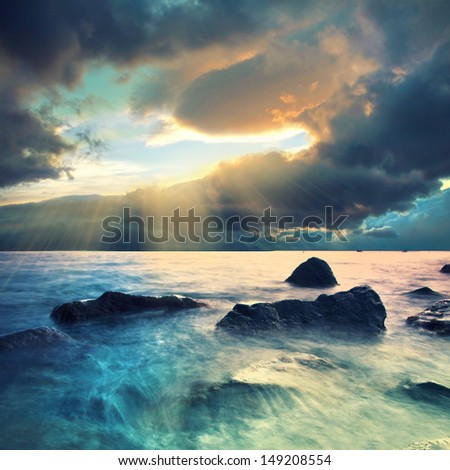 stormy clouds over the sea coastline - stock photo