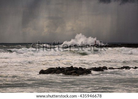 Stormy late afternoon with rain and wind at the fishing harbor and marina of Vila do Conde and Povoa do Varzim entrance. North of Portugal.l - stock photo