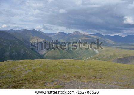 Stormy mountain landscape - stock photo