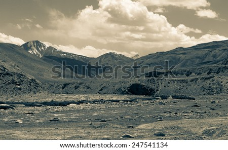 Stormy mountain river in valley in the foothills of the Fann mountains. Landscape. Toned. - stock photo