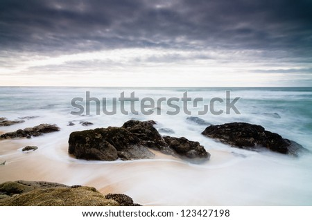 Stormy ocean beach - California, United States - stock photo