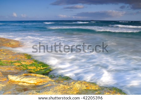 Stormy ocean sunrise - stock photo