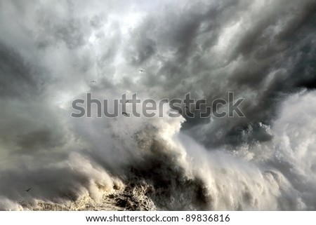 Stormy ocean wave breaking the shore - stock photo