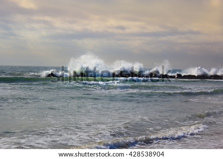 Stormy ocean waves, beautiful seascape, big powerful tide in action, storm weather in a deep blue sea, forces of nature, natural disaster.
