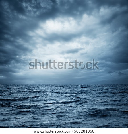 Stormy Sea and Sky. Thundery Clouds and Gray Ocean. Wild Nature Dark Dramatic Background. Toned and Filtered Square Photo with Copy Space.