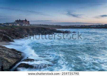 Stormy sea at dusk looking out over Fistral beach in Newquay, Cornwall - stock photo