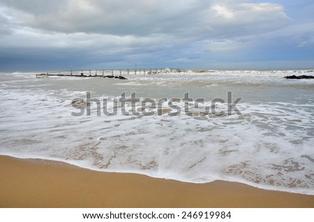 stormy sea at sunset in summer - stock photo