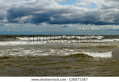 Stormy sea in a cloudy day.