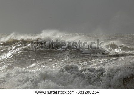 Stormy sea waves with interesting winter light before rain