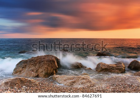 Stormy sea with a colorful sky - stock photo