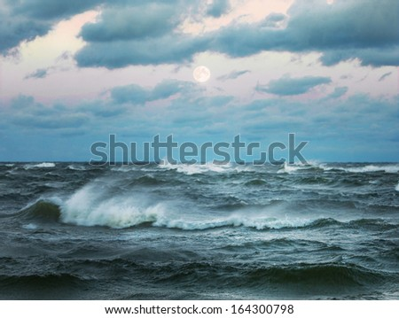 Stormy sea with beautiful moon - stock photo