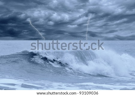 stormy sea with lightning in the sky - stock photo