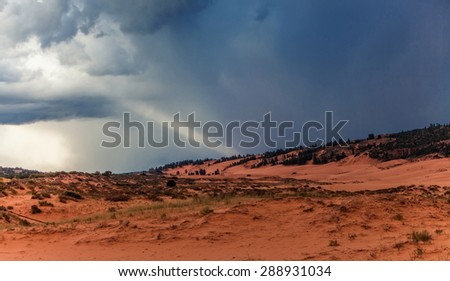 Stormy sky and clouds before sunset above the Coral Pink Sand Dunes State Park near Kanab, Utah, USA - stock photo