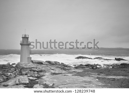 Stormy sky over a lighthouse in black and white in Muxia, Spain