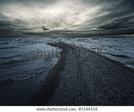 Stormy sky over dark sea. - stock photo