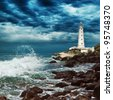 Stormy sky over lighthouse sits on the edge of the Crimean peninsula - stock photo