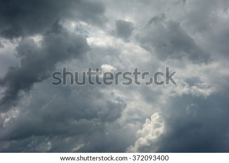 stormy sky with dark clouds - stock photo